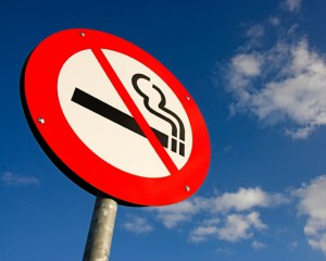no smoking sign against the blue sky